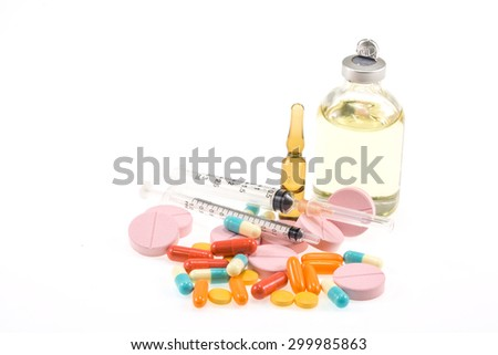 various medicines, pills and syringes on a white background - stock photo