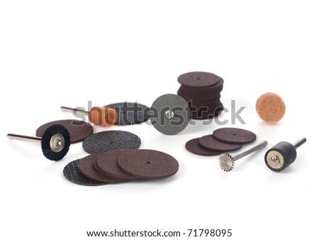 Various mini rotary tool bits. Shot against white background. - stock photo