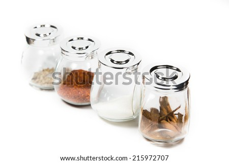 Various mixture, seasoning, in glass bottle on white background - stock photo