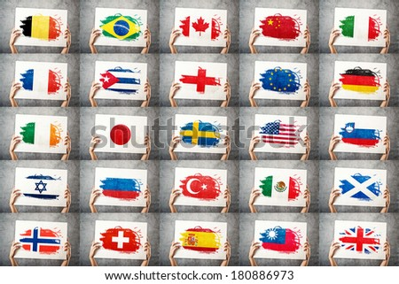 Various national flags collection. Man holding banner with grunge Flag. Supporting national team, patriotism concept. - stock photo