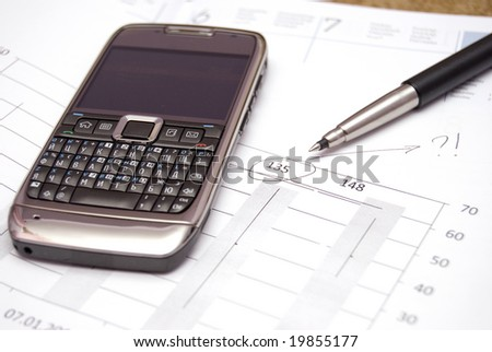 Various office supplies and mobile phone - stock photo