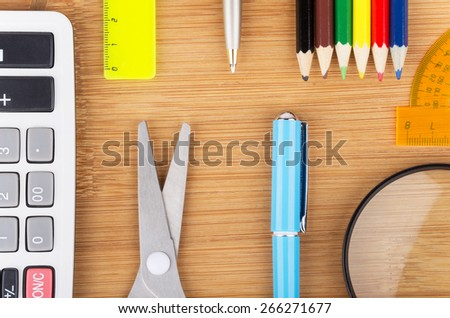 Various office supplies on wooden table surface - stock photo