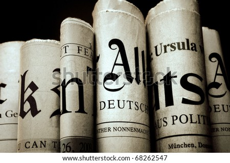 Various old newspapers over black background - stock photo