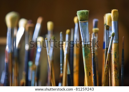 Various paint brushes. - stock photo