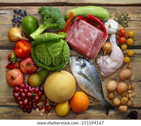 Various Paleo diet products on wooden table, top view - stock photo