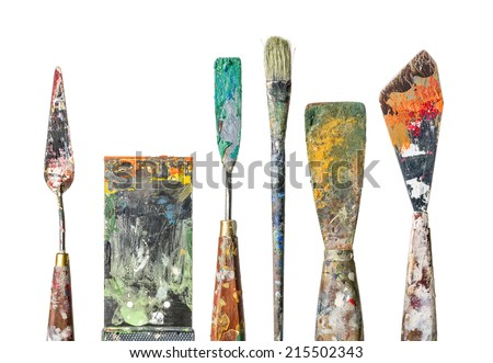 Various palette knives and a brush on a white background - stock photo