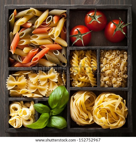 various pasta in black wooden box - stock photo