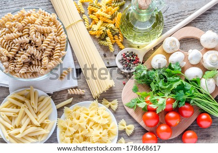 Various pasta with mushrooms and cherry tomatoes - stock photo