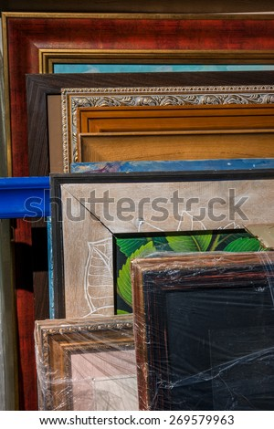 Various pictures in frames in a studio - stock photo
