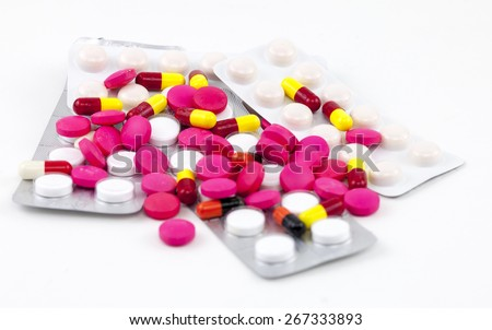 Various pills in white isolated background - stock photo