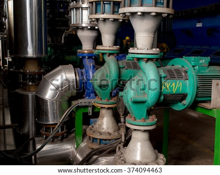 various pumps, valves and piping hot and cold water - stock photo