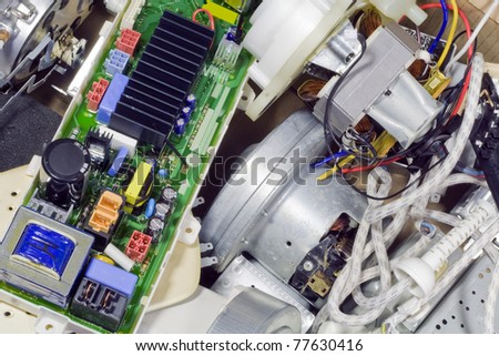 Various rejected  broken spare parts from household electronics on garbage dump. Mass production. - stock photo