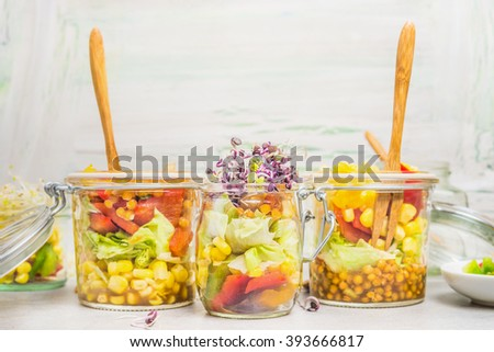 Various salads in jars for clean take away eating on light background, close up. Healthy lifestyle or diet food concept - stock photo