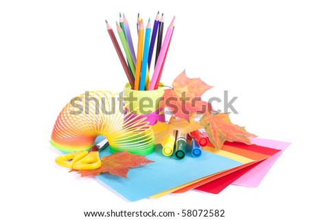 Various school accessories to children's creativity and autumn leaves on a white background. Concept for Back to school - stock photo