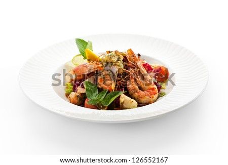 Various Seafood Salad with Basil Leaf and Cherry Tomato - stock photo