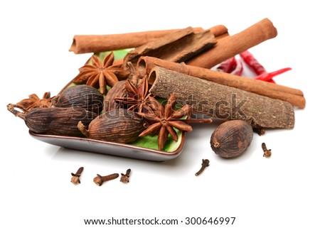 Various seasonings on white background  - stock photo