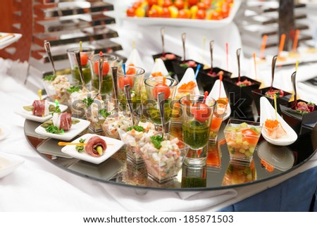 Various snacks on table, banquet food - stock photo