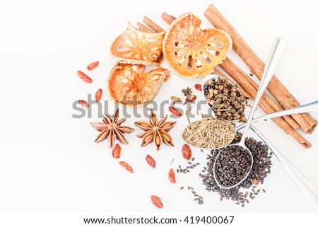 Various spices, herb  and ingredients on white background - stock photo