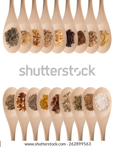 Various spices on wooden spoons isolated on white - stock photo