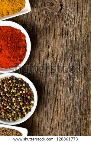 Various spices on wooden table. - stock photo