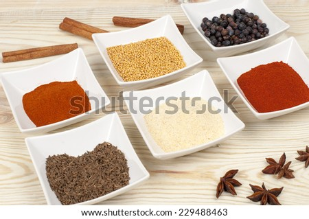 various spices on wooden table - stock photo