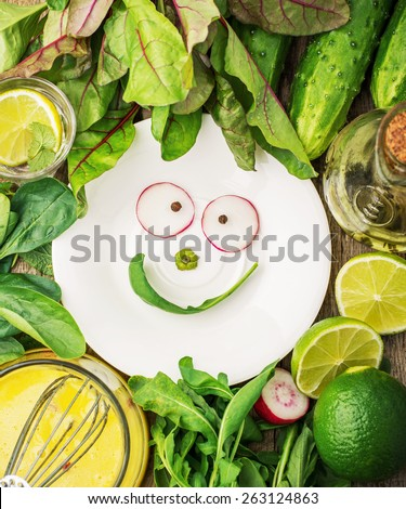 Various spring vegetables and herbs along with easy home dressing for a healthy diet with space for text. With a smile, vegetables and arugula. selective Focus - stock photo