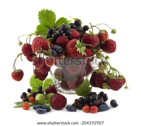 Various summer berries in glass vase isolated on white - stock photo