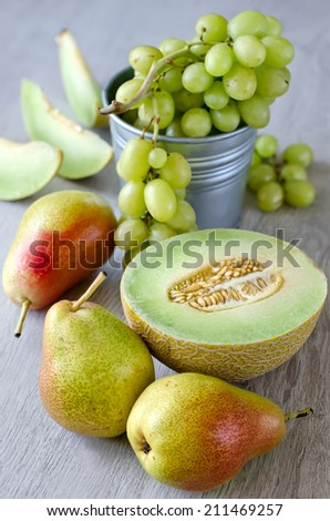Various summer fruits, wooden background  - stock photo