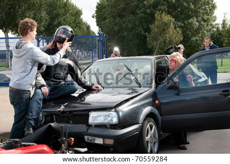 Various things happening just after an accident between a motorcycle and a car. - stock photo