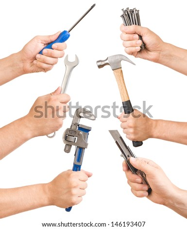 Various tools in a man's hand. - stock photo
