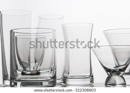various type of glasses on a mirrored desk - stock photo