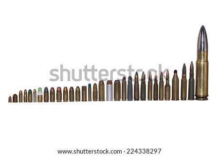 various types and calibers of ammunition, sorted by size, isolated on white - stock photo