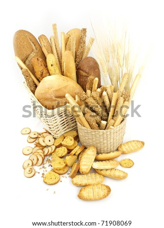 Various types of bread and other wheat products in the basket - stock photo