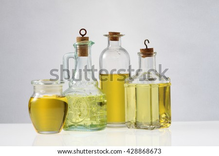 Various types of oil in bottles - stock photo