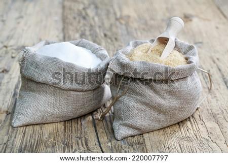 Various types of sugar, brown sugar and white - stock photo