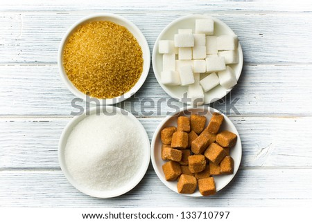various types of sugar in ceramic bowls - stock photo