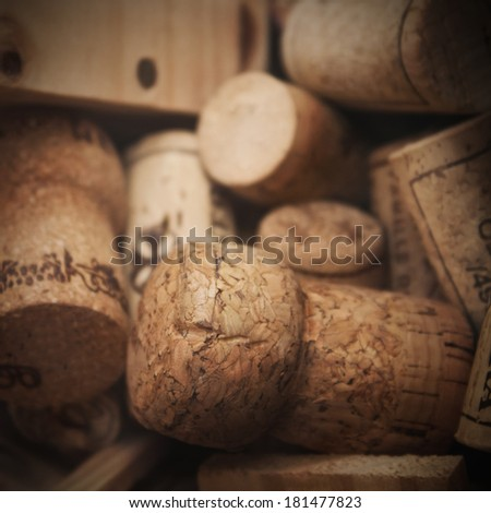 Various used wine corks in a wooden box - stock photo
