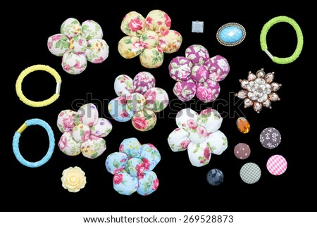 Various vintage Sewing element and fabric flower isolated on a black background. - stock photo