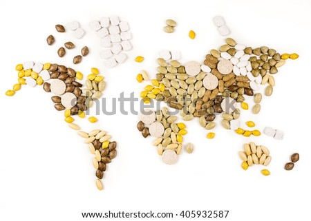 various vitamin supplements forming map of the world on white background - stock photo