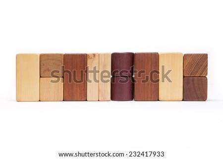Various wood blocks(oak, walnut, teak, pine) like a wall isolated white at the studio. - stock photo