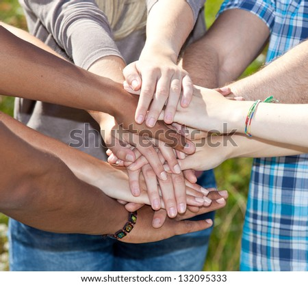 Various young persons showing symbol of loyalty. - stock photo
