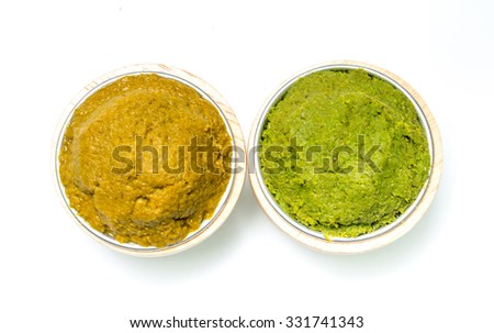 varity Thai cuisine nam prik or chili paste spices of Thailand in cup ready for cooking thai foods on white background - stock photo