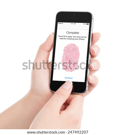 Varna, Bulgaria - December 07, 2013: Woman is scanning fingerprint by Apple Space Gray iPhone 5S Touch ID, designed by Apple Inc. Isolated on white background. - stock photo
