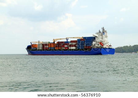 VARNA, BULGARIA - JULY 01: Turkish cargo ship HILDE A (Year Built: 2005, DeadWeight: 22033 t) is sailing away into open sea after a short stay in Varna-west port on July 01, 2010 in Varna, Bulgaria. - stock photo