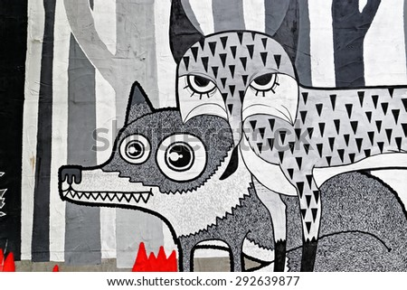 Varna, BULGARIA - June 21, 2015: Street art by unknown artist of fox and wolf in the woods. - stock photo