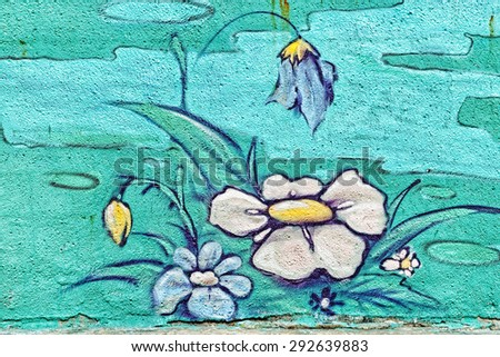 Varna, BULGARIA - June 21, 2015: Street art by unknown artist on a concrete wall close to Port of Varna of flowers with white and blue petals. - stock photo