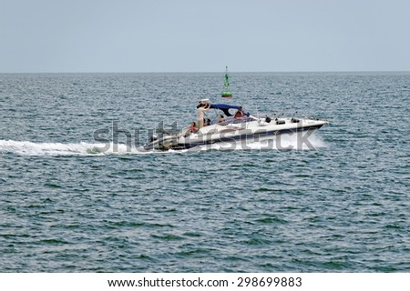 Varna, BULGARIA - June 21, 2015: Unidentified private pleasure boat is cruising in Bay of Varna. Such luxurious vessels are mainly used as attraction for solvent tourists during the summer season.  - stock photo