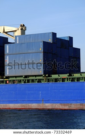 VARNA, BULGARIA-MAR 14: Turkish cargo ship HILDE A (Year Built: 2005, Dead Weight: 22033 t) sails away into open sea after a short stay in Varna-west port on March 14, 2011 in Varna, Bulgaria - stock photo