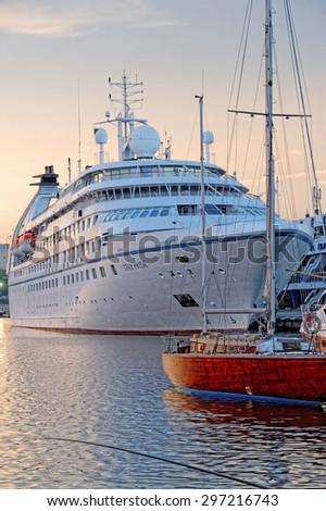VARNA, BULGARIA - MAY 26, 2015: Passenger ship STAR PRIDE at dusk (Year Built: 1988, Flag: Bahamas) moored in Port of Varna. - stock photo
