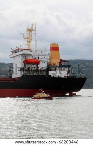 VARNA, BULGARIA - NOVEMBER 27: Cargo ship VOLA 1  (Year Built: 1992, Flag: Malta) sails into open sea after a major revamp work on November 27, 2010. Ship's destination is Port of Mariupol, Ukraine. - stock photo